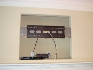 Mounting the fireplace TV bracket